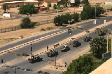 Military vehicles in the Sudanese capital Khartoum, shown in an image grab taken from a video by an anonymous source