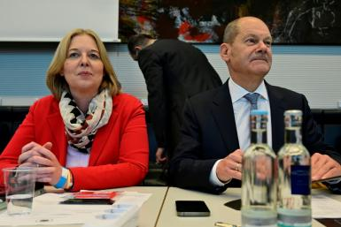 Social Democrat Baerbel Bas, shown next to Finance Minister Olaf Scholz, is expected to become the third woman speaker of the Bundestag