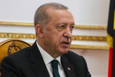 Turkish President Recep Tayyip Erdogan, pictured during a state visit to Angola on October 18, 2021, on Monday backed down from a threat to expel 10 Western ambassadors over their joint statement of support for a jailed civil society leader