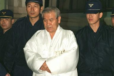 Former South Korean president and general Roh Tae-woo (C) was instrumental in crushing the Gwangju Uprising at a cost of hundreds of lives