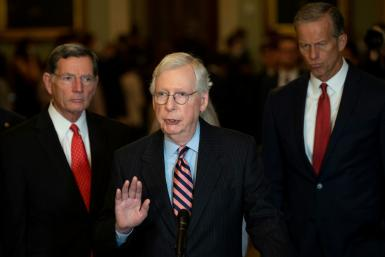 US Senate Minority Leader Mitch McConnell (center) blamed pandemic aid programs for fueling inflation