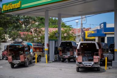 Vehicles lined up at a closed gas station in Port-au-Prince, Haiti