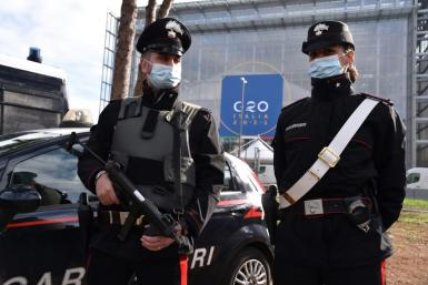 Carabinieri police officers stand guard outside the 'Nuvola' convention centre ahead of the G20 summit