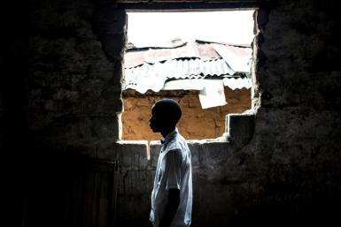 A former child soldier studies at a reintegration facility