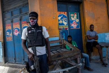 A Haitian National Police officer stands guard in Port-au-Prince, Haiti, on October 27, 2021
