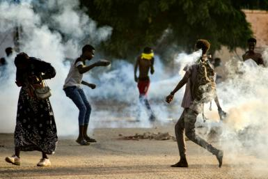 Sudanese youths confront security forces amid demonstrations against a military takeover this week