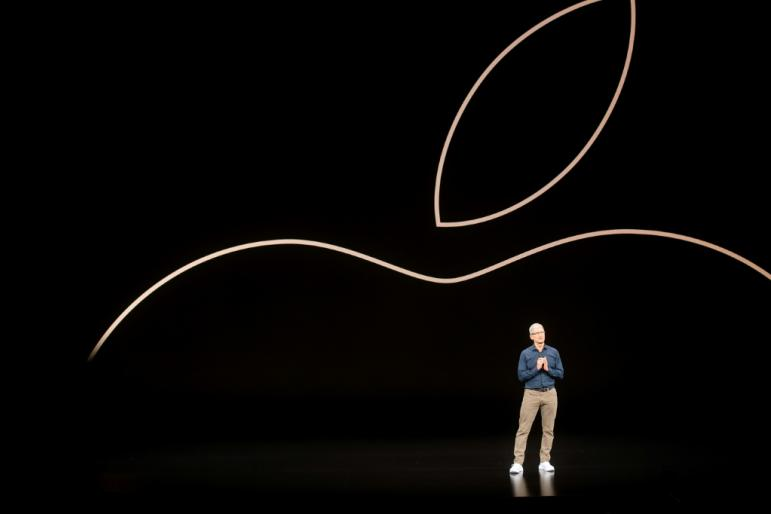 Apple CEO Tim Cook, seen at the 2018 iPhone launch event, is expected to unveil new handsets but also speak about content and services that are increasingly important to the tech giant