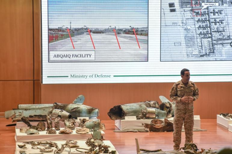 Saudi defence ministry spokesman Turki bin Saleh al-Malki displays pieces of what he said were Iranian cruise missiles and drones recovered from the attack site that targeted Saudi Aramco's facilities