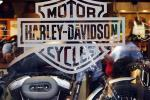Motorcycle maker Harley Davidson's logo appears on the window of a store in Boston