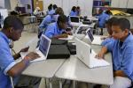 Students at the Lilla G. Frederick Pilot Middle School work on their laptops during a class in Dorchester, Massachusetts