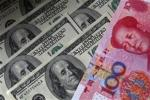A 100 yuan banknote is placed next to $100 banknotes