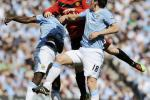 Manchester City's Toure and Barry challenge Manchester United's Rooney during their English Premier League soccer match in Manchester on 17/04/2010.