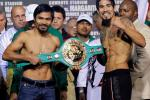 Manny Pacquiao of the Philippines (L) and Antonio Margarito of Mexico pose with the championship belt during the weigh-in for their upcoming WBC super welterweight championship fight at Cowboys Stadium