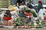 Women sell vegetables and fruits on the roadside in Nairobi, Kenya