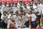 Members of Indian cricket team pose with the trophy after winning their third test match and the series against New Zealand in Nagpur.