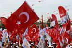 Supporters of Turkey's main opposition Republican People's Party wave flags during an election rally in Istanbul
