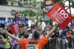 A gay marriage supporter carries a sign at the 41st LGBT Pride parade in San Francisco