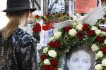 A woman observes a moment of silence at a memorial place for the late entertainer Michael Jackson in Munich