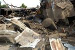 Shattered remnants are seen at the site of a bomb blast at a bar in the Nigerian