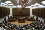 Members of the Slovak Parliament vote on the euro zone rescue fund in Bratislava