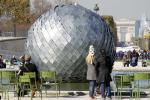 "The sculpture ""Una misteriosa bola, 2011"" by French artist Antoine Dorotte is displayed in the Tuileries Garden in Paris"