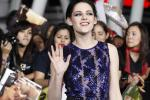 "Cast member Kristen Stewart poses at the premiere of ""The Twilight Saga: Breaking Dawn - Part 1"" at Nokia Theatre in Los Angeles"