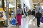 A woman carries shopping bags at South Park mall in Charlotte