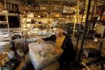 Trent Arsenault looks at his supply of specimen cups at his home in Fremont, California