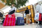 A woman rests while shopping at South Park mall in Charlotte