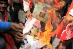 Activists of Bajrang Dal burn greeting cards shout slogans during protest against Valentine's Day celebrations in Bhopal