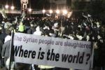 Demonstrators gather during a protest against Syria's President Bashar al-Assad in Homs February 10, 2012.