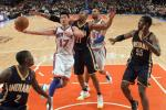 New York Knicks guard Jeremy Lin (17) drives past Indiana Pacers forward David West (21), guard Darren Collison (2) and center Roy Hibbert (55) in the third quarter of their NBA basketball game at Madison Square Garden in New York March 16, 2012.