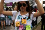 A woman takes part in the SlutWalk, held to protest against discrimination and violence against women in Lima
