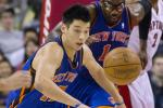 Jeremy Lin chases a loose ball in the first half of their NBA basketball game against the Toronto Raptors in Toronto March 23, 2012.