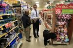 U.S. President Barack Obama buys a bone for his dog Bo in Alexandria