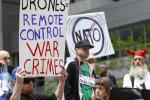Peace activists take part in anti-NATO demonstration outside of Obama's campaign headquarters in Chicago