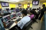 File photo of stock brokers trading in a brokerage firm in Kolkata February 16, 2009.