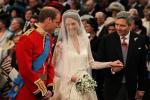 Britain's Prince William stands at the altar with his bride, Kate Middleton, and her father Michael, during their wedding at Westminster Abbey in central London