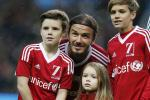 David Beckham and his children Cruz, Romeo and Harper pose before a charity football match