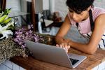 Small business owner works on her laptop