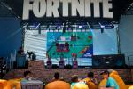 Fans rest on pillows at the 2019 Fortnite World Cup Finals - Round Two at the Arthur Ashe Stadium in New York City in July 2019