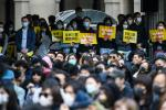A rally by workers from the advertising sector this week. Violence has lessened in Hong Kong protests following recent local elections