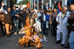 Activists protest against the rape and murder of a 27-year-old woman in India. Police later shod dead the four detained suspects as they re-enacted the crime