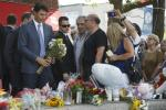 Canadian Prime Minister Justin Trudeau lays flowers at a memorial for victims of a mass shooting in Toronto July 30, 2018