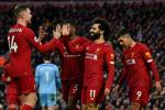 22 reasons to cheer: Mohamed Salah (2nd right) and Jordan Henderson (left) scored in Liverpool's victory over Southampton