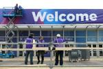 As organisers were considering whether to cancel this year's Mobile World Congress, workers were hanging up the 'welcome' sign at the Barcelona venue