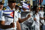 Members of the Navy display a picture of Cuban former president Fidel Castro during the May Day parade at Revolution Square in Havana, on May 1, 2016