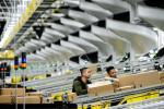 Amazon said it is implementing new safety measures including temperature checks for empoyees at warehouses as part of its efforts to contain the coronavirus pandemic