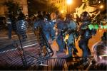 Police charge a barricade in the street during a demonstration against the death of George Floyd, near the White House on May 31, 2020 in Washington