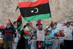 Residents of Tripoli celebrate after Libya's UN-recognised unity government announces it is back in full control of the capital and its suburbs